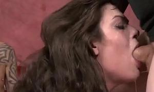Naive looking slut deep throats 2 cocks