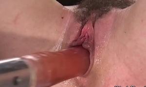 Toned hairy pussy babe fucks machine
