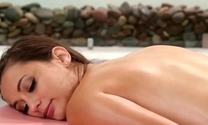 Young les masseuse rubbing MILFs hairy pussy